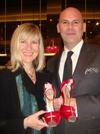 "Carrie Lannon and ferragamo store manager donald lyons holding a limited edition numbered ""Lady Sarah"" evening shoe"