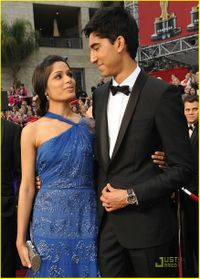 Oscars - freida pinto in john galliano and dev patel
