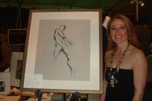 Blog 28 - Diana McCartney standing beside beautiful charcoal and watercolor donated by Francine Turk