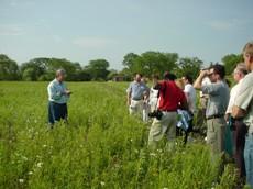 Bill kurtis leading a tour of mettawa manor