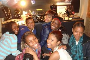 Gallery - After School Matters students in front of the jewelry that they created to sell