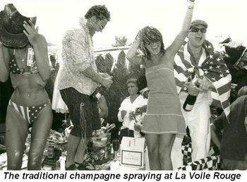 Blog 8a - The traditional champagne spraying at La Voile Rouge