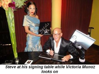 Blog 1 - Steve at his signing table while Victoria Munoz looks on