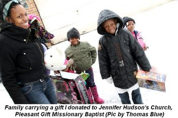 Blog 14 - Family carrying a gift I donated from Jennifer Hudon's church,  Pleasant Gift Missionary Baptist