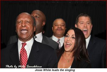 Jesse White leads the singing