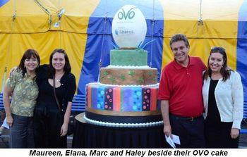 Blog 2 - Maureen, Elana, Marc and Haley Schulman beside their OVO cake