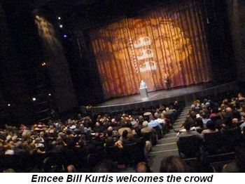 Emcee Bill Kurtis welcomes crowd at Harris Theatre