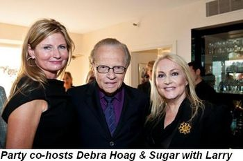 Party co-hosts Debra Hoag and Sugar with Larry