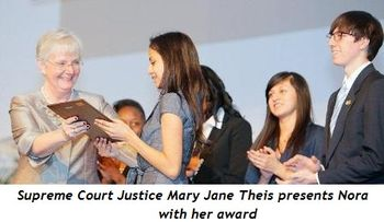 Blog 1 - Supreme Court Justice Mary Jane Their presents award to Nora