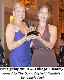 Blog 1 - Paula giving the PAWS Chicago Visionary Award to The David Duffield Family's Dr. Laurie Peek