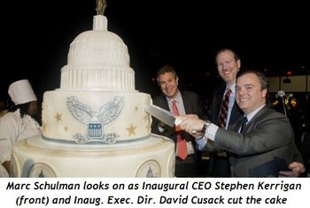 4 - Marc Schulman looks on as Inaugural CEO Stephen Kerrigan (front) and Inaug. Exec. Dir. David Cusack cut the cake