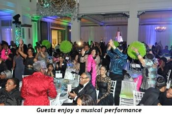 10 - Guests enjoy a musical performance