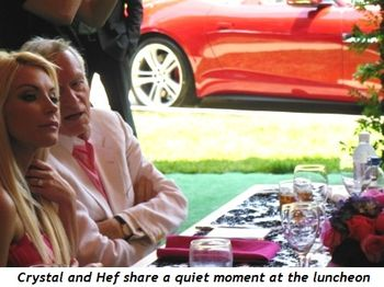 10 - Crystal and Hef share a quiet moment at the luncheon