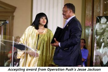 Accepting award from Operation Push's Jesse Jackson