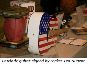 Patriotic guitar signed by rocker Ted Nugent