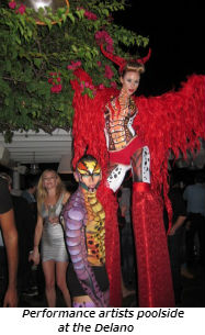 Performance artists poolside at the Delano