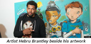 Artist Hebru Brantley beside his artwork
