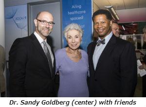 Dr Sandy Goldberg center with friends