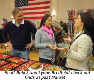 Scott Bobek and Lynne Bredfeldt check out finds at past Market