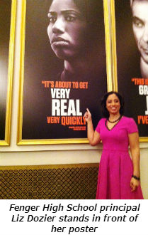 Fenger High School principal Liz Dozier stands in front of her poster