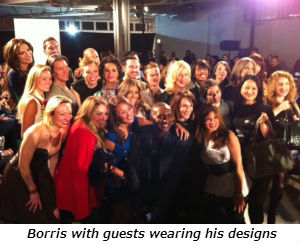 Borris with guests wearing his designs