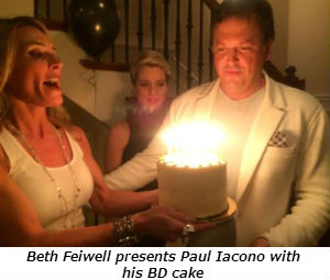 Beth Feiwell presents Paul Iacono with his BD cake