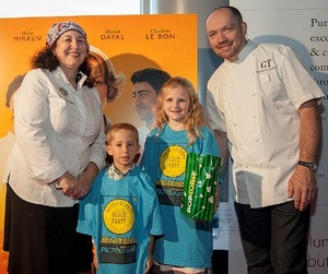 Chefs Carrie Nahabedian and Giuseppe Tentori w/ kids from Pilot Light