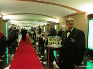 Servers with champagne line the entry to the Auditorium Theatre