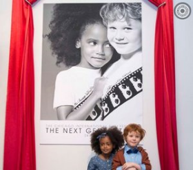 Noah Warren and and Braden Crothers pose beside their Festival poster (Pic by Timothy M. Schmidt)