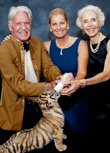 Michael Butler, Reute Butler and Jorie Butler Kent feed a 7 wk-old Bengal tiger