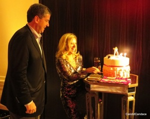 Sharyl Mackey cuts her cake as her loving husband Mike looks on