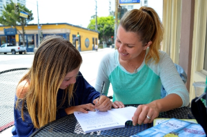 Summer and friend writing in a Trust Journal