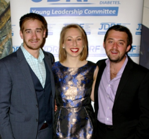 Oliver Stone, YLC Member Laura Ihry and Matt Bergh