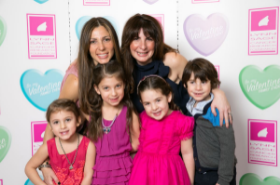 Event co-chairs Sherri Hoke and Joanna Aaron with their kids.